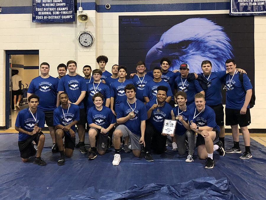 The boys powerlifting team wins first overall. Twelve boys placed in the top five with five of the lifters placing first.