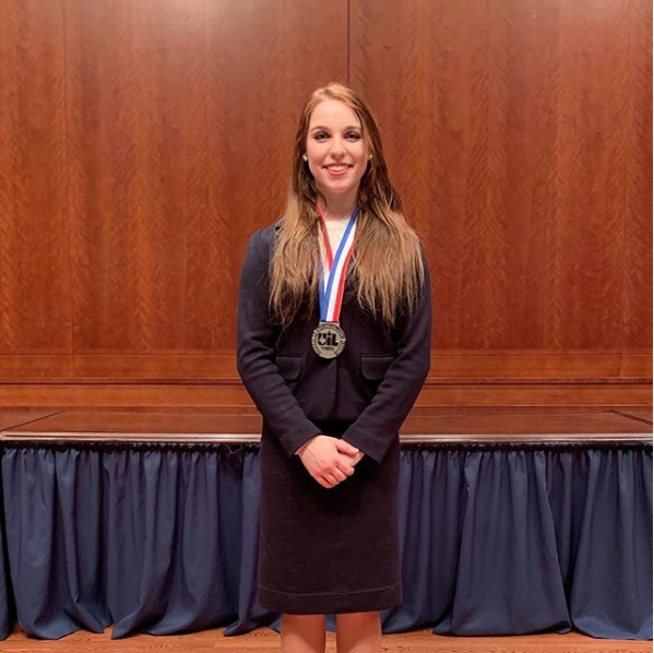 Ashlyn Ellgass with the silver medal she received at state for congress debate. The competition was held January 7-9 in Austin.