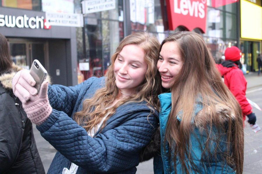 Kaitlyn Gibson and Sydni Segroves pose together for a selfie in Time Square.