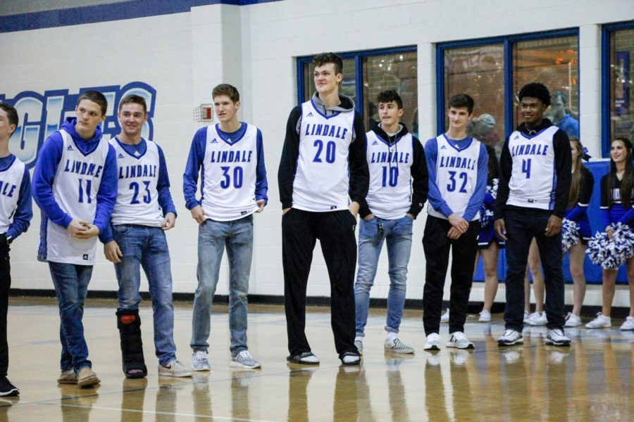 The boys' basketball team is presented at Meet the Eagles. Varsity has won 12 out of 17 games played.