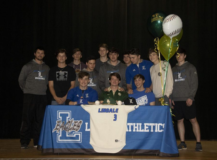 Brown poses with his teammates. He will be playing for Baylor University in Waco.