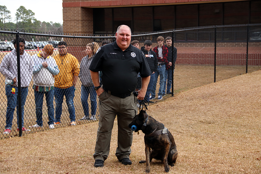 Kevin Petty works with his K-9 officer Hunter. The team showed off Hunter's skills.