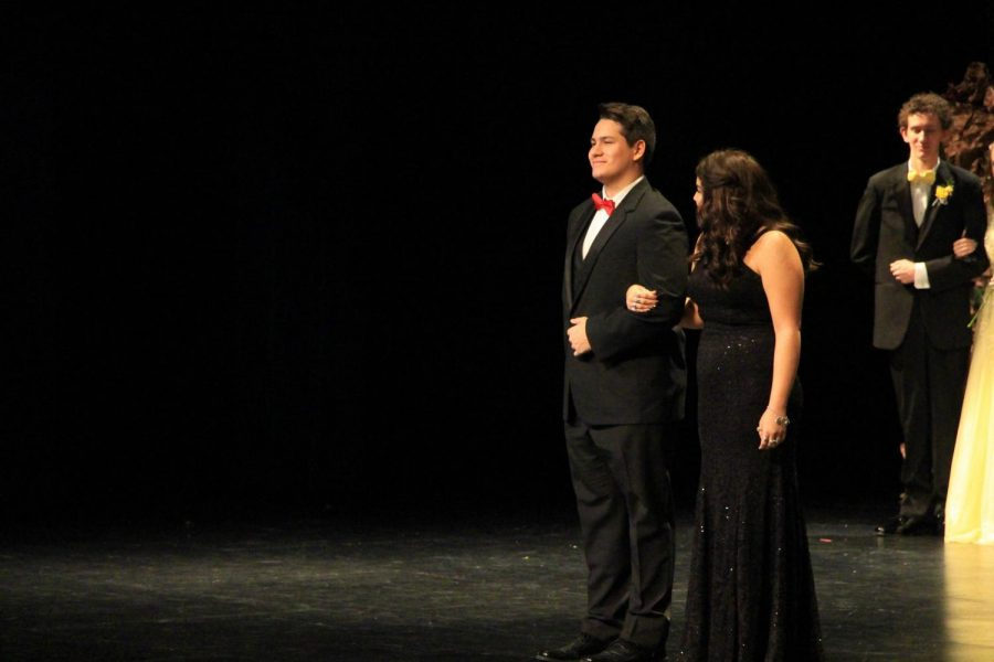 Senior Jonah Flores escorts senior Haylee Haxton across the stage. Haxton was nominated as a candidate for queen at coronation.