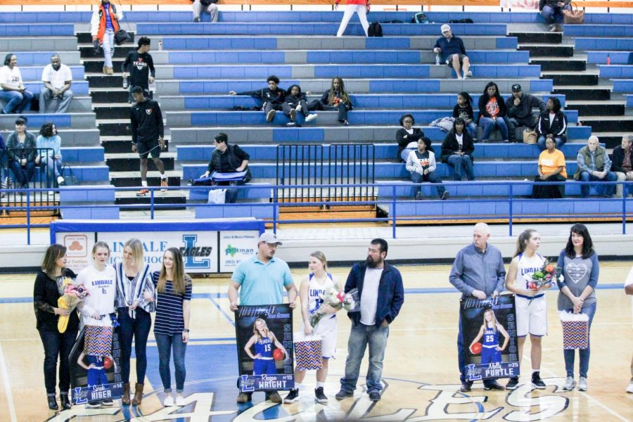 Seniors Sarah Kiser, Reagan Wright and Molly Purtle are presented at senior night. They were escorted by family members to be acknowledged for their dedication to the team.