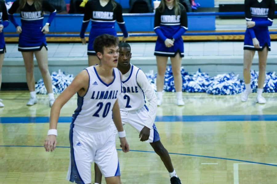 Seniors Cody Collinsworth and Teigan Edwards prepare for the opposing team to rush down the court. Edwards plays as the starting point guard and Collinsworth plays as a post.