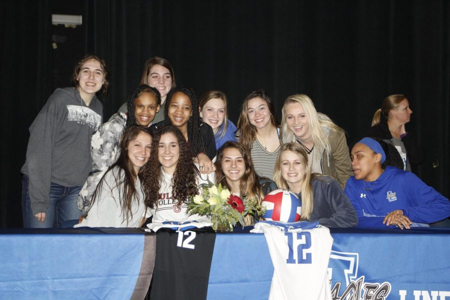 Moyer poses with her fellow Lindale volleyball players. She will be playing college ball at Union University in Jackson, Tennessee.