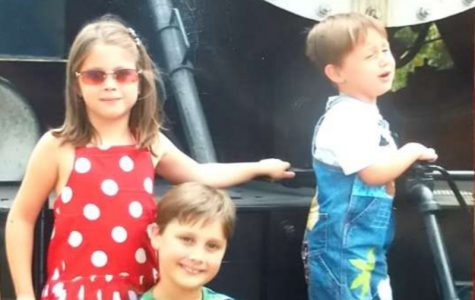 (From left to right) Siblings Sydney, Matthew and Joshua Smith stand on a train waiting for their picture to be taken. This picture  portrays three different types of people, and respectively their emotions.