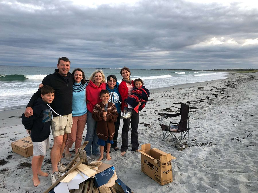 Snow with her family on a beach. She travels with her family often.