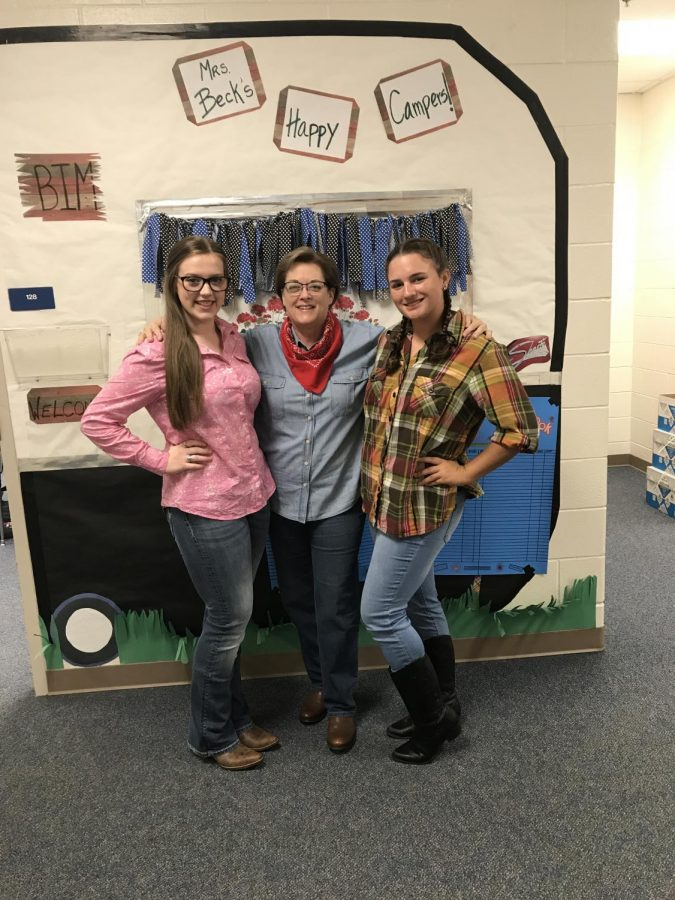 Teacher Lynda Beck celebrates western day with students Alanna Kologey and Keslie Cook. Beck has participated in numerous spirit days during her years at LHS.