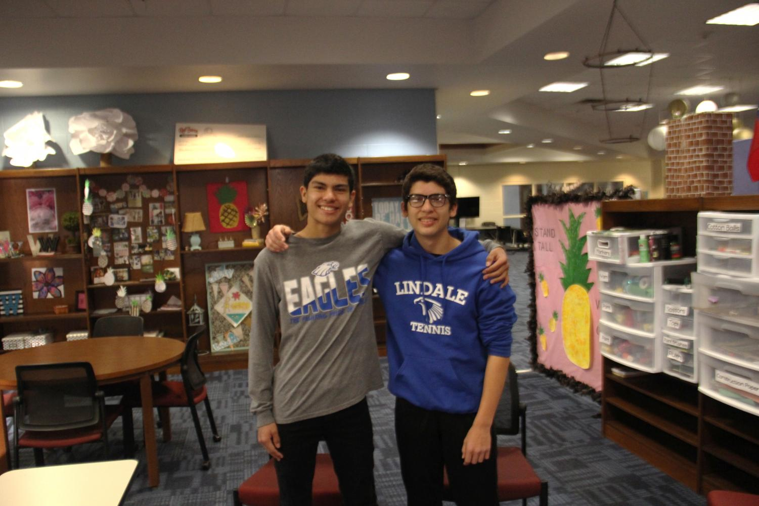 Senior Rick Samaraweera and sophomore Andre Samaraweera pose in the library. The two brothers began attending school at the beginning of last year.