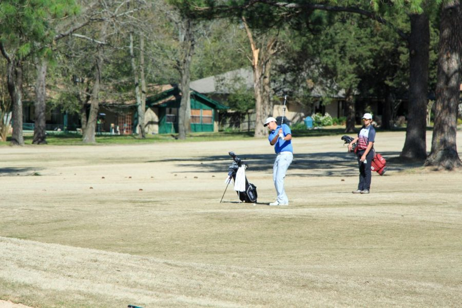 Senior Ryan Esparza practices his swing before hitting the golf ball. They began the tournament at 8 a.m.