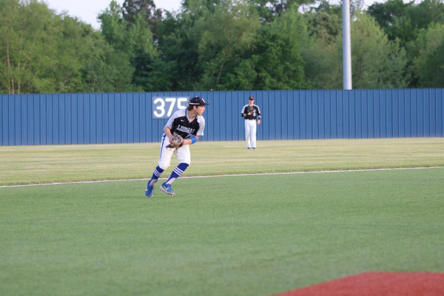 Sophomore Brandon Burckel makes a throw to get a Texas High runner out at first. The Eagles won 7-3 to improve to 8-4 in district play.