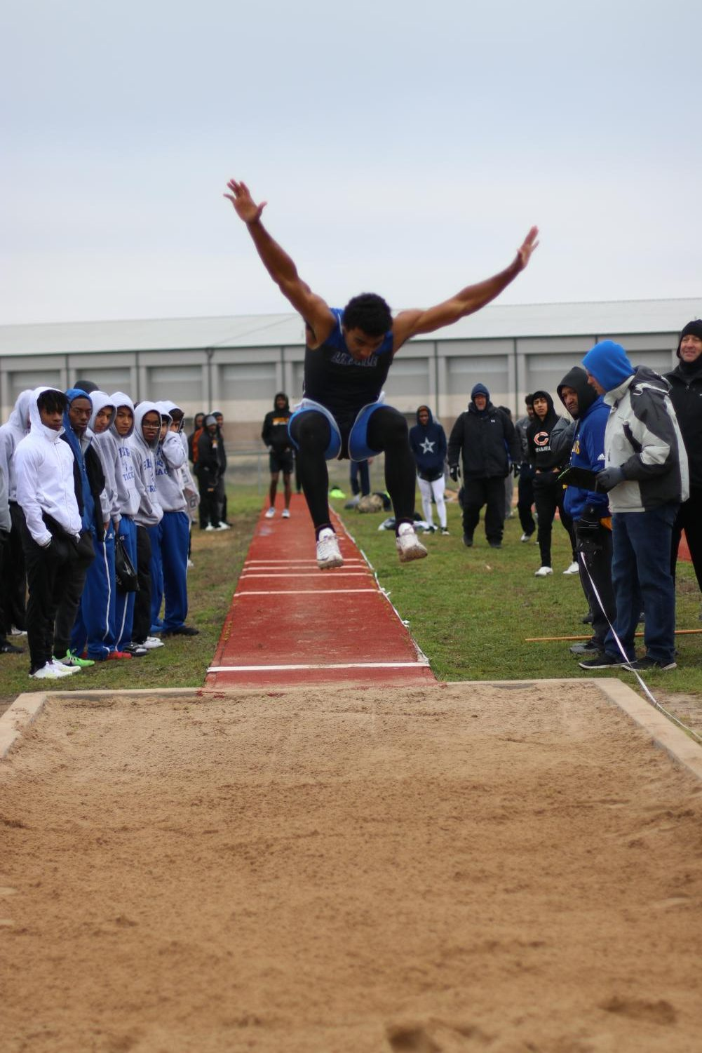 Sophomore Jordan Jenkins jumps into the long jump pit. He placed 6th in the meet at Sulphur Springs.
