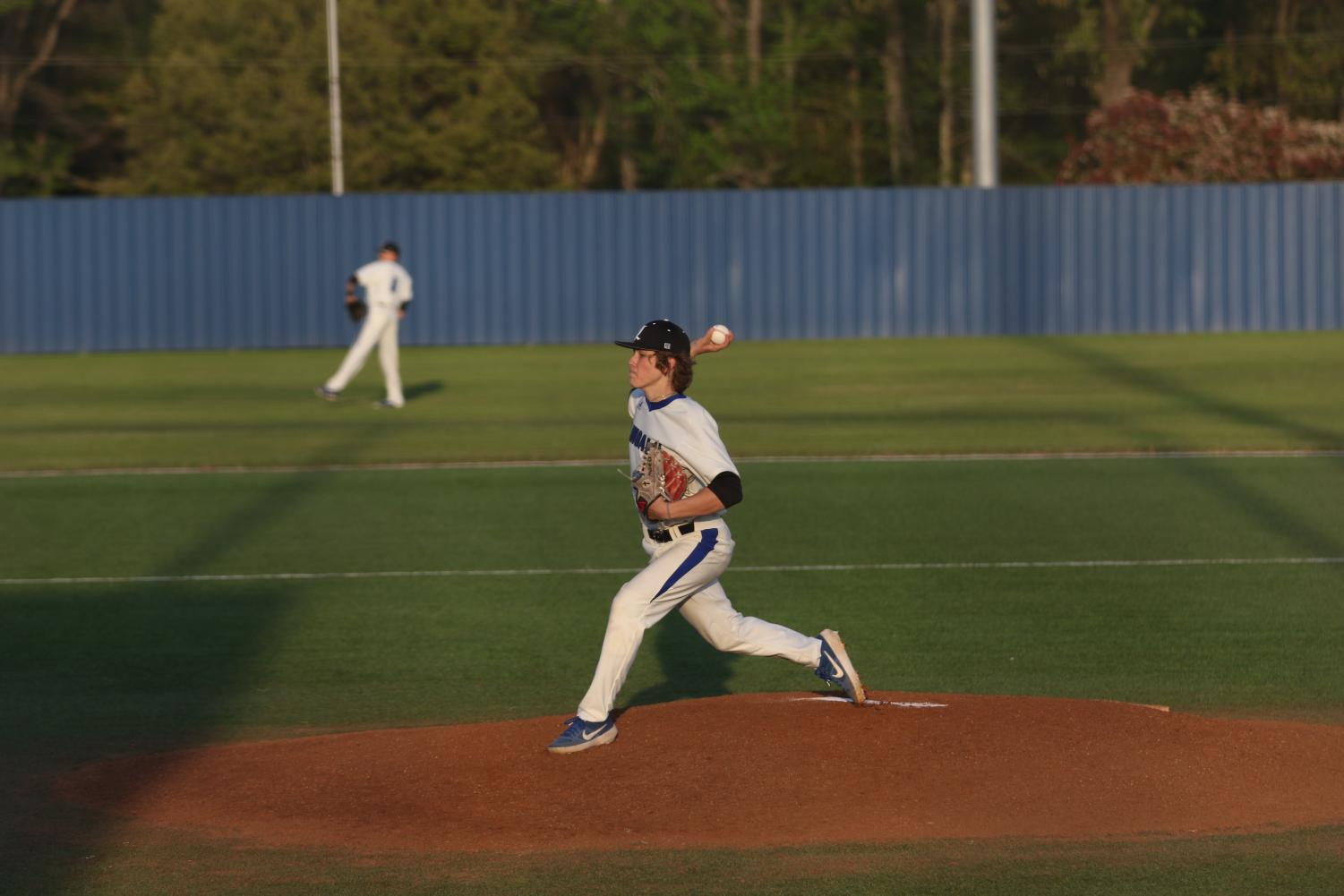 Senior Landon Chaney pitches the ball to a Sulphur Springs batter. The Eagles varsity team won the game 4-1 and also beat Sulphur Springs three games to none in their district series.