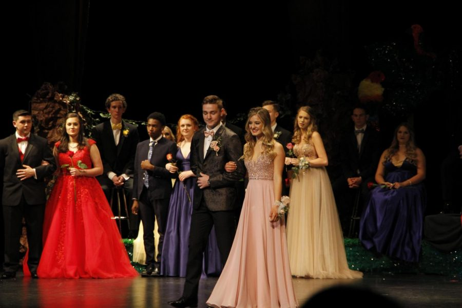 Senior Lainey Goodson is escorted by senior Colton Brown at coronation. Goodson was nominated to be a duchess.