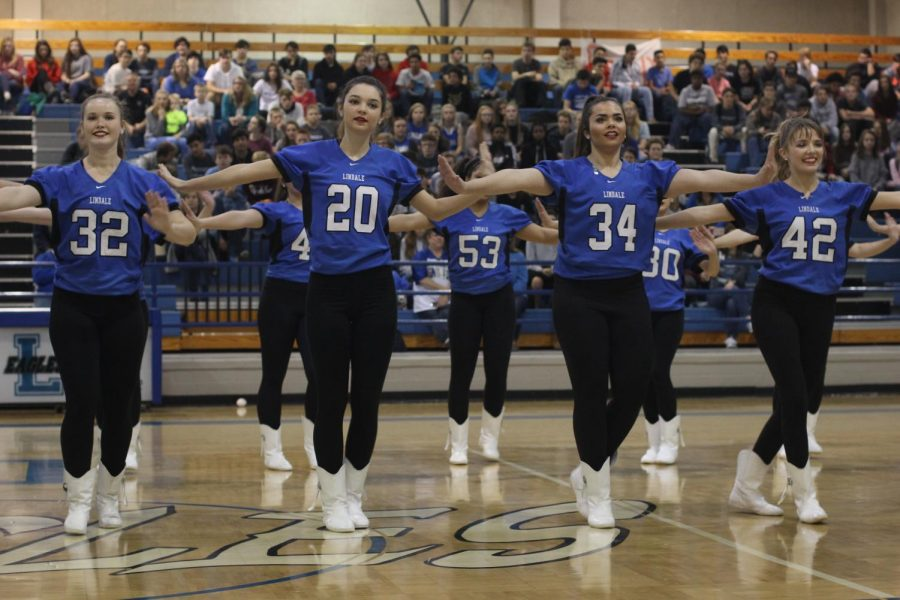 The Starsteppers perform a dance routine at the pep rally. Also known as the drill team, Starsteppers performs during halftime at all of the football games.