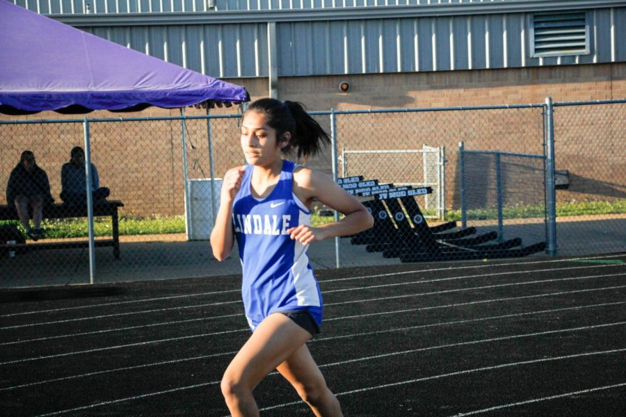 Freshman Nataly Tapia competes against against in track. The competition was held on March 26.