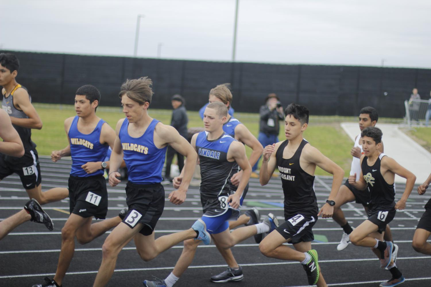 The track team competes at district in Royse City.
