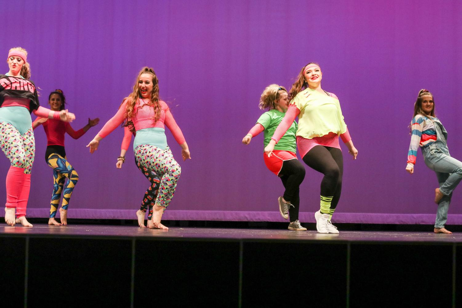Senior+Lindsey+Roach+performs+a+dance+routine+from+the+1980s+alongside+other+Drill+Team+members.+They+prepare+for+these+routines+for+weeks+before+the+show.