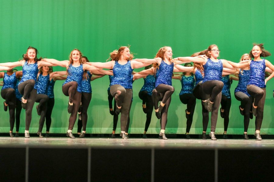 Pep Squad members perform a kick routine near the end of the show. Many members audition to be in Drill Team after their first year in Pep Squad.