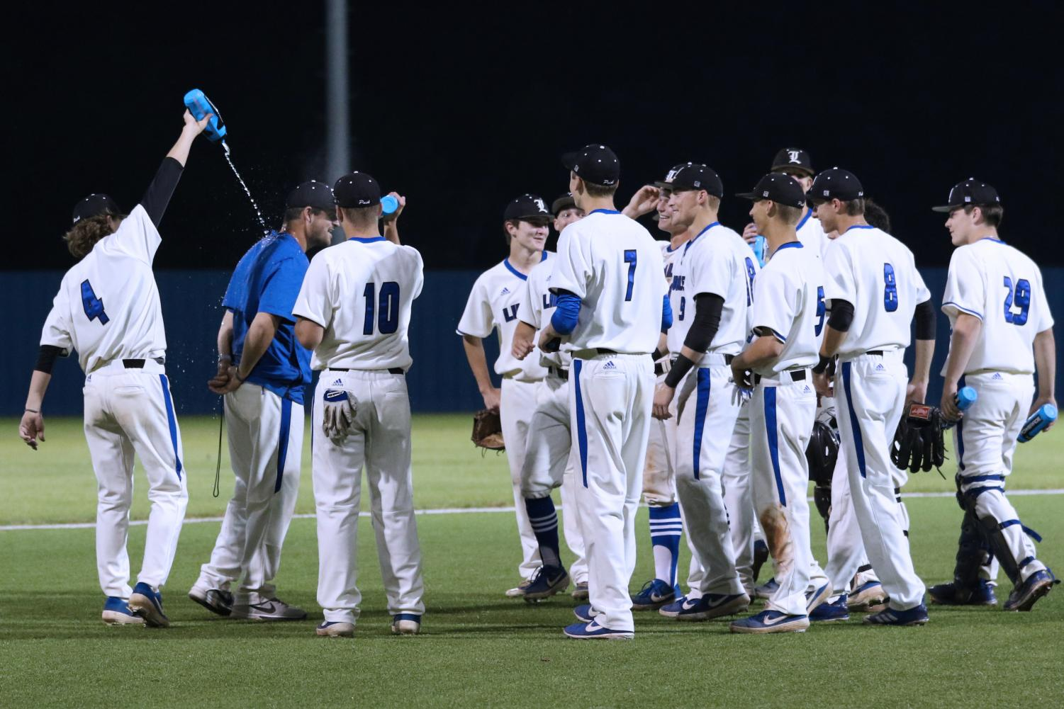 The varsity baseball celebrates their home win over Greenville, and they were officially named the district champions following this game. Head coach Rich Sanguinetti is the district's Coach of the Year, and several players also received district awards.