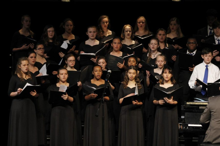Choir+students+sing+during+their+spring+choir+concert.+Both+the+junior+high+and+high+school+combined+together+to+sing+for+their+last+performance+of+the+concert.