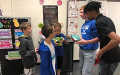 Advanced Programming Students Mentor 3rd Grade Robotics Competitors