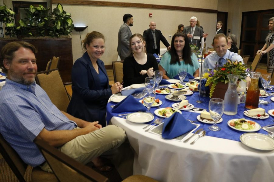 Senior Mara Griffin dines with Katy Lyles, her chemistry teacher, and her family at the top ten banquet.