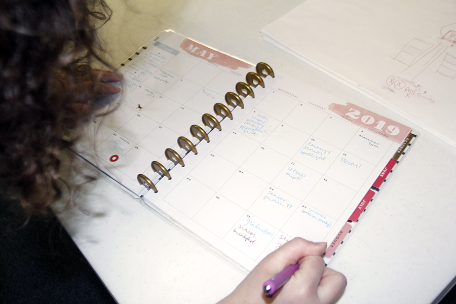 Annie Evans fills out her planner. She worked very hard to avoid stress her senior year.