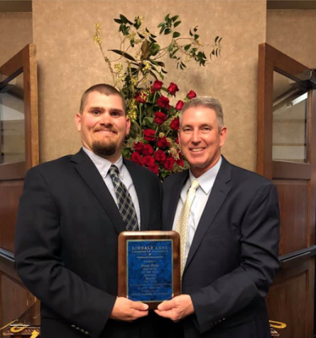 Coach Brent Ricks receives Chamber Educator of the year. Superintendent Stan Surratt congratulated him for his 8 years of coaching and teaching.