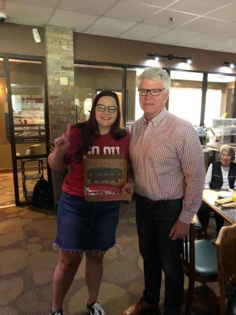 Senior Carlee Pascual holds her University of Oklahoma acceptance box as she poses with Dean Ed Kelley. She will be majoring in journalism.