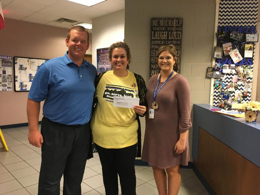 Student Council co-sponsor Dare Kirklin receives a grant of $1,500. Student Council earned the grant after hosting three blood drives last school year.