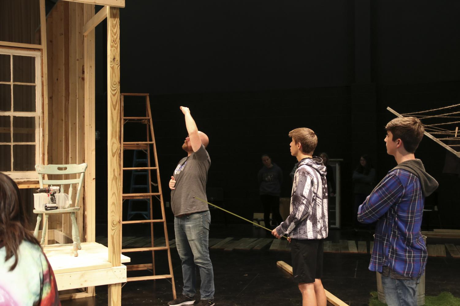 Theater director John Jarman instructs his students on his vision for the set of Picnic. The setting takes place outside on labor day weekend.
