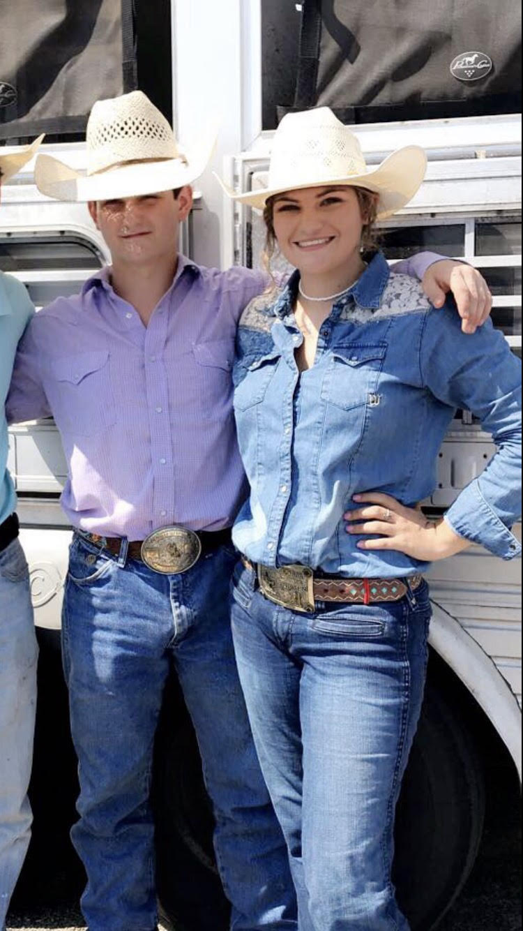 Ty Roach and Kristen Riley outside their trailer. They won the ribbon roping contest.  Photo Courtesy of Kristen Riley.