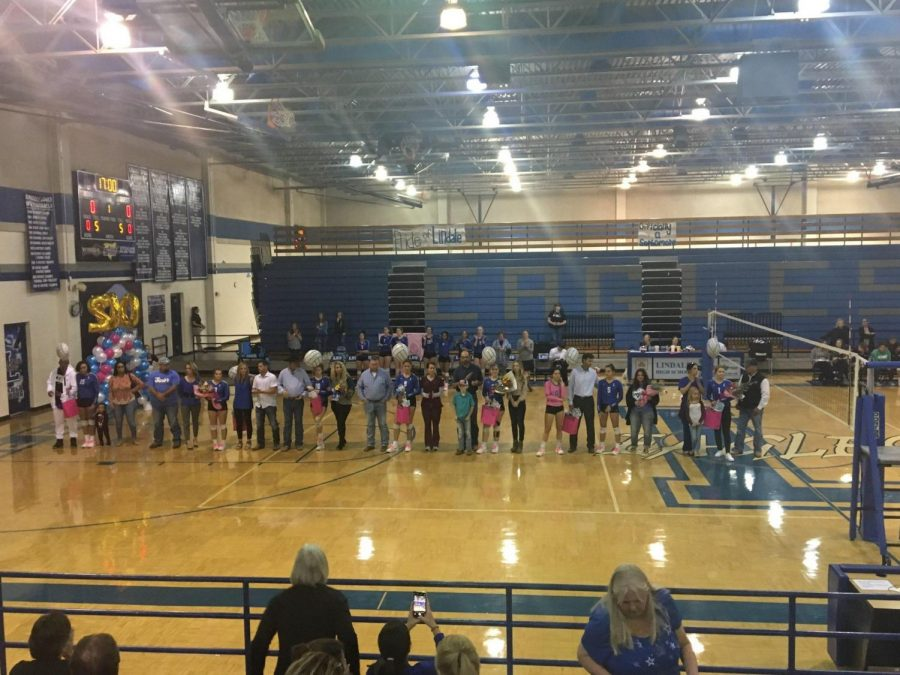 The volleyball seniors stand with their families before the senior night game. The team won the game over Royse City in four sets.