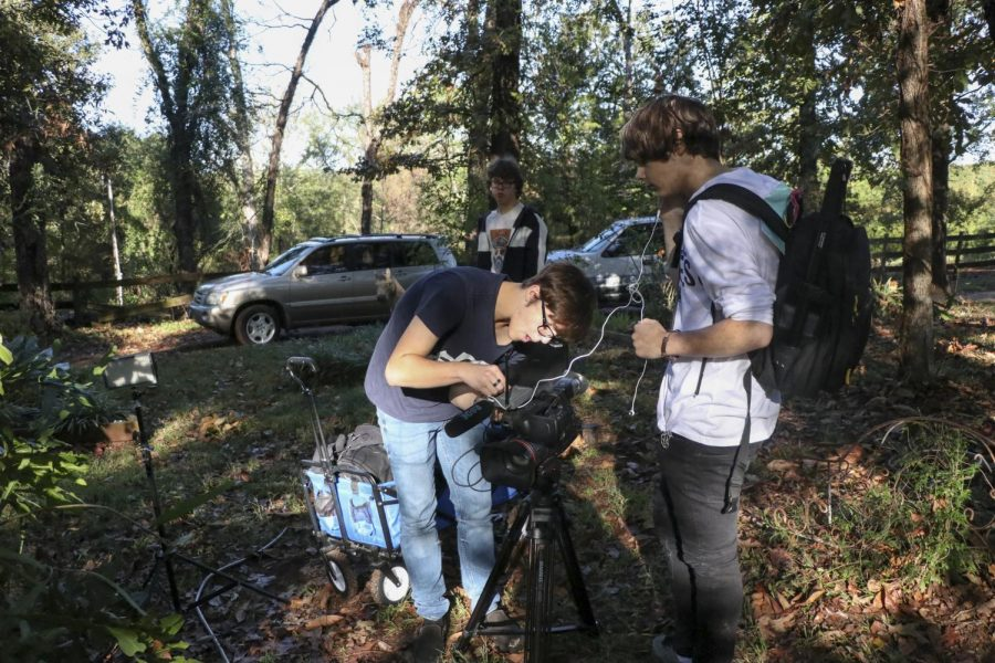 Sophomore+Miles+Hill+and+Senior+Jude+Ratcliff+set+up+the+camera+for+filming.+The+film+club+was+filming+the+first+narrative+film.