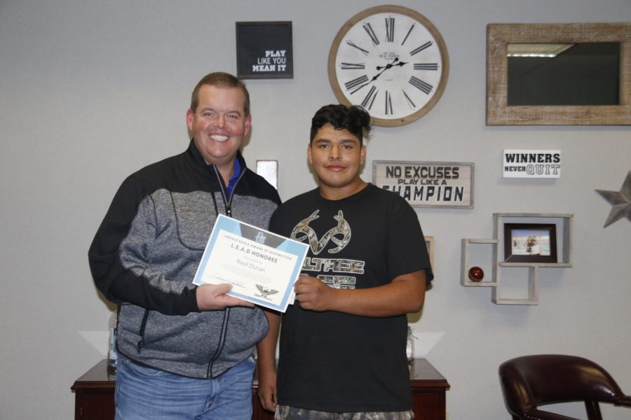 Raul Duran poses with principal Jeremy Chilek. Duran is the November Student of the Month.