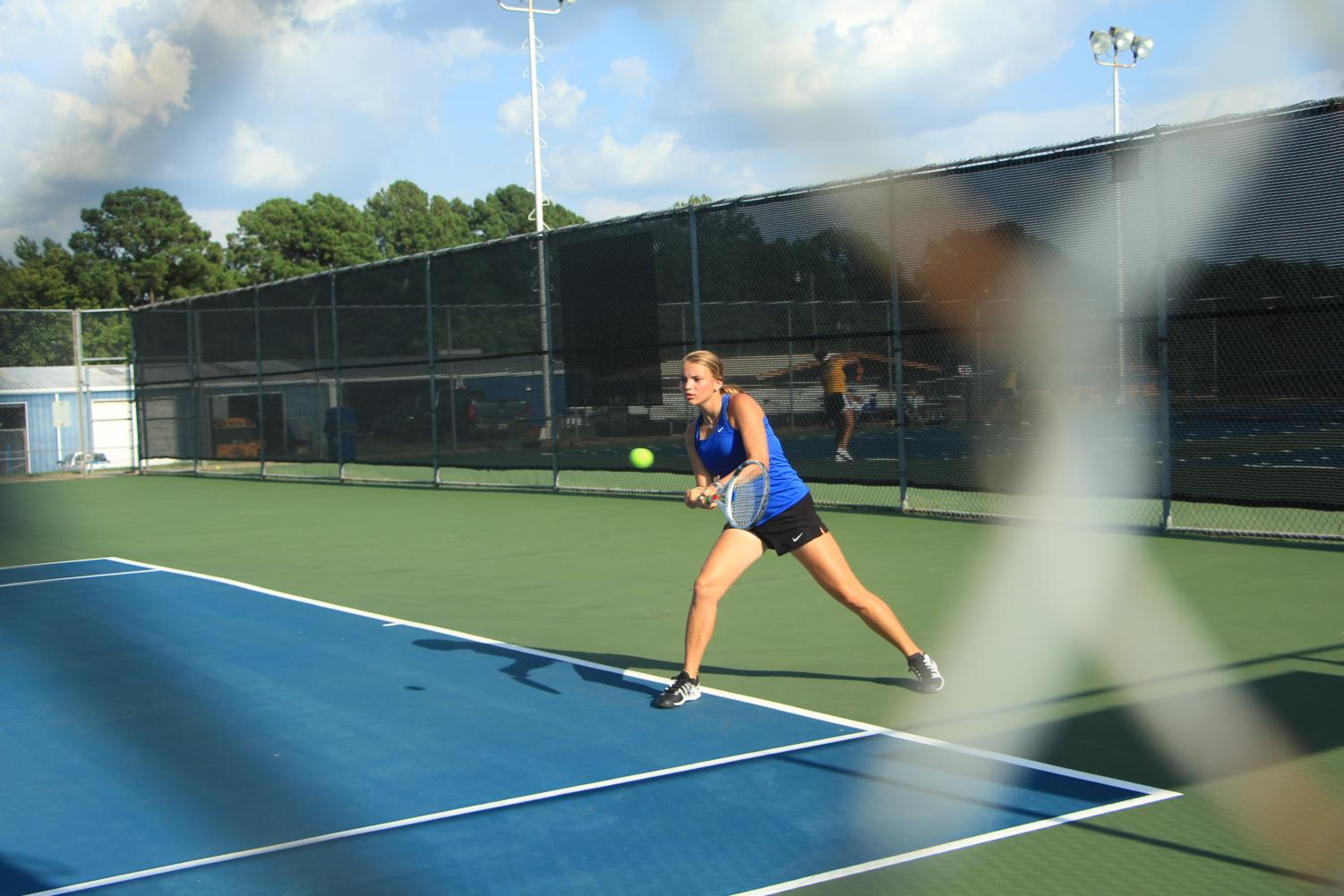 Junior Abby Van Andel competing in the Corsicana tennis tournament. She started her high school tennis career her freshman year.
