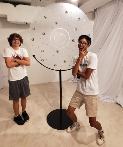 Junior Sam Lee (right) Jeffrey Ptak (left) visit The Big Store, a Chance The Rapper pop-up shop,  while taking a break from Lollapalooza.