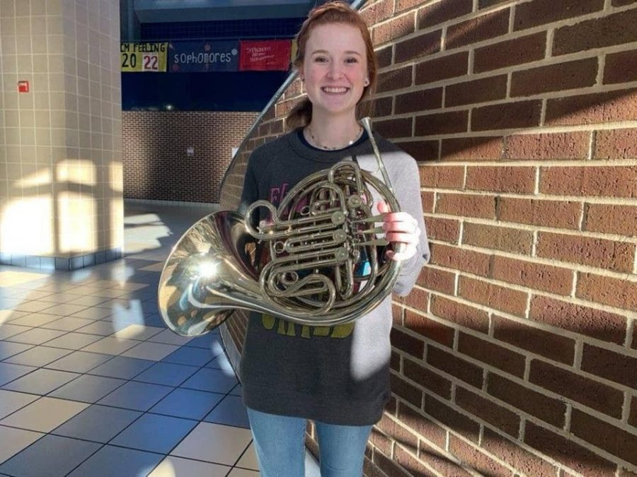 Junior+Chloe+Harbuck+poses+with+her+French+Horn+after+making+the+All-State+Band.+She+decided+to+compete+in+conference+6A.