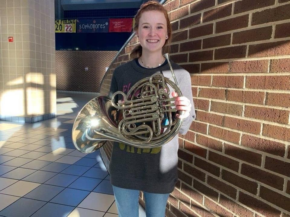 Junior Chloe Harbuck poses with her French Horn after making the All-State Band. She decided to compete in conference 6A.