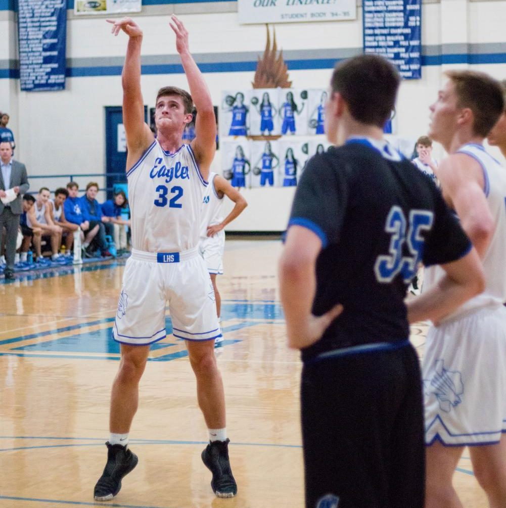 Senior Jacob Koeshall shoots a free throw in the game against Grace Community. The point from this shot counted as his 1000 point in his career.