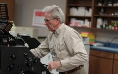 Retired teacher Tommy Mallory works in the print shop. He has worked for the district for 47 years.