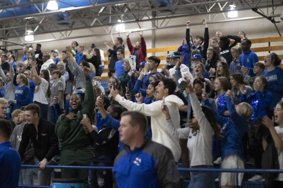 The student section roars after lindale scores a point during the basketball game. I love the energy that I get to show with my friends for the basketball team. Junior Jared Maeker said.