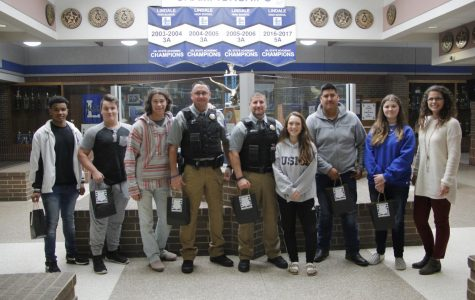 The Law Enforcement class poses while giving the campus police officers a goodie bag. This was to show support to the local police officers on National Law Enforcement Day.