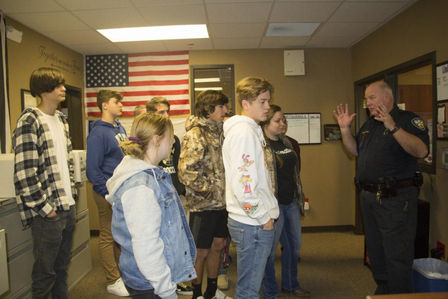 Chief Somes show the students the 911 dispatch area were the officers are given orders on were they need to go. He explained how important this room is the Lindale Police Department and how big of an impact it makes.