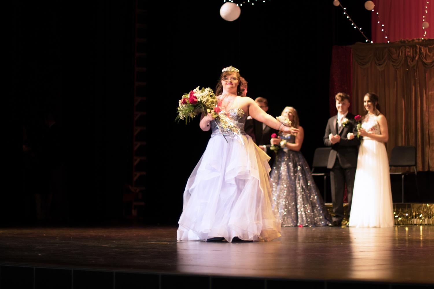 Senior+Abby+Somes+steps+forward+and+poses+after+accepting+her+crown.+She+was+announced+Coronation+Queen+on+Saturday+among+3+other+nominees.