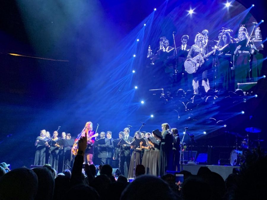 The chorale performs with Miranda Lambert on stage. The chorale performed at the American Airlines center on Feburary 8.