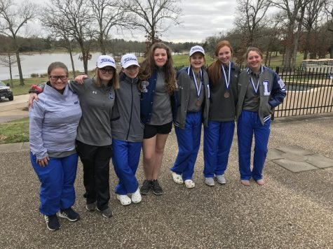 The girl's golf team poses fora picture following their third place finish at the Garden Valley meet.
