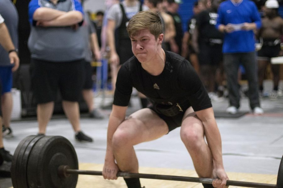 Senior Henry Waggoner lifts the bar off the ground. This was at one of the recent powerlifting meets.